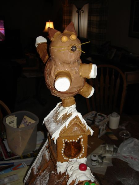 Dancing gingerbread cat